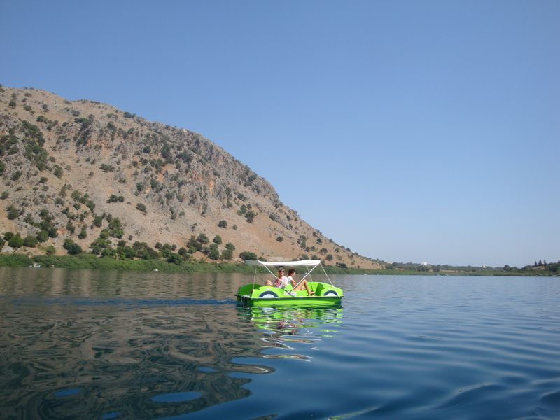 001. Apple-green catamaran on Lake Kournas - (Η λίμνη Κουρνά). This is a unique freshwater lake on Crete Island witch will astonish you with its different hues of water and varieties of flora and fauna. Where else could you find a lake where you could enjoy sweet wild grapes while sailing up to its shore on your catamaran, to see turtles and playing of golden fish?