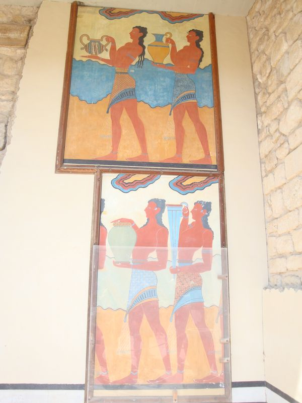 045. Procession - The frescoes are from the extension of the Corridor of Processions which takes its name from the murals on its walls that feature people walking along it. Initially, all frescoes at Knossos were only in red colors. Knossos (Κνωσσός)