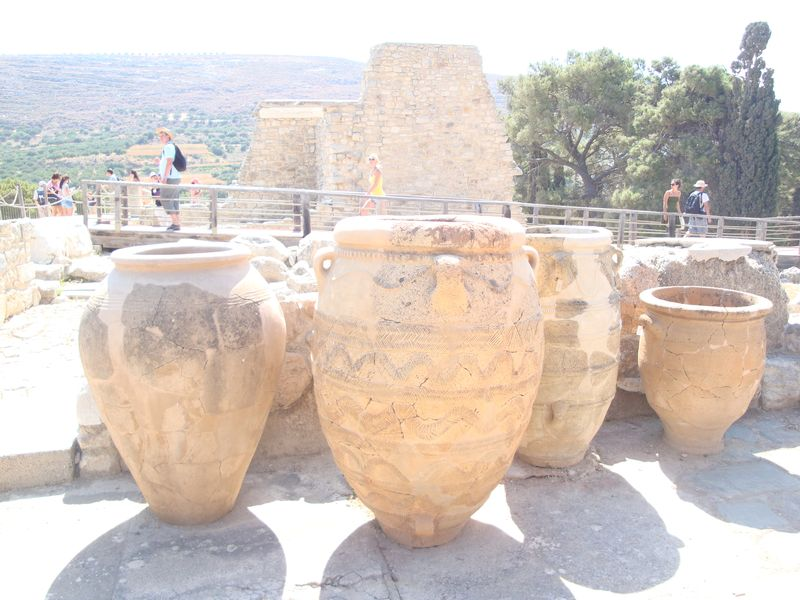 046. Storage jars, or pithoi, at Knossos - (Κνωσσός). These jars are as tall as a man! Pithos (pl. Pithoi), or Πίθος, Πίθοι on ancient Greek, is a large earthenware storage jar.