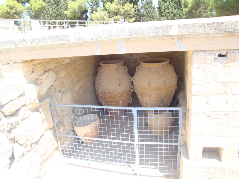 065. Giants storage jars, or pithoi, at Knossos - (Κνωσσός). Storehouse of pithoi is approximately 4000 years old. In ancient Greek Pithos (pl.Pithoi), or Πίθος, Πίθοι, is a large earthenware storage jar