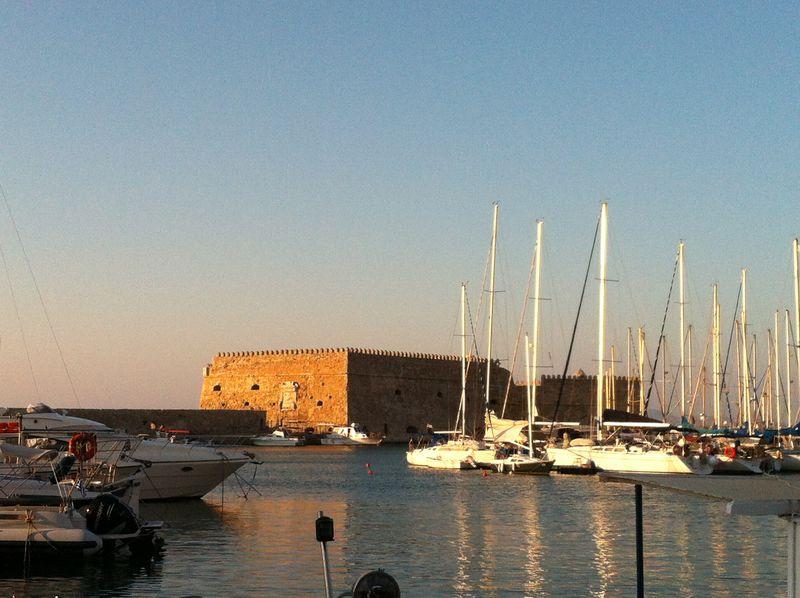 108. Fortress in the rays of sunset - View of Koules Fortress (Greek: Κουλές, Italian: Rocca al Mare). Heraklion (Greek: Ηράκλειο)