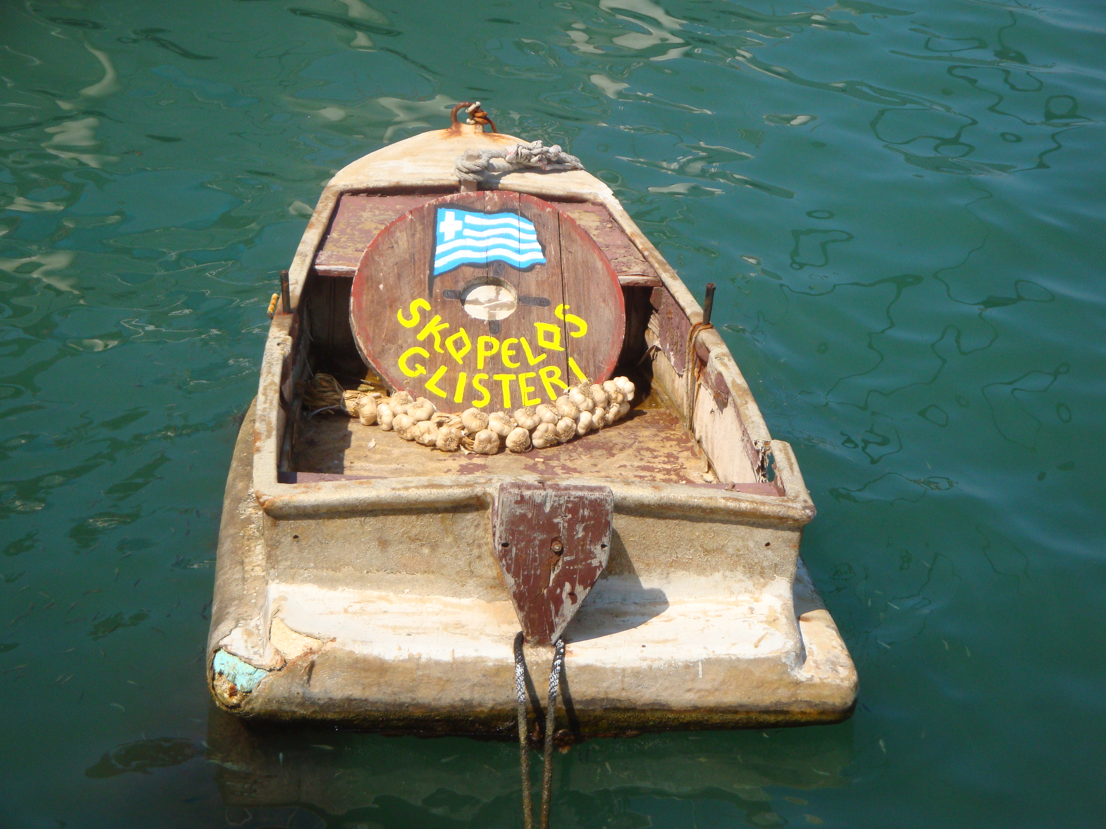 The old-fashioned boat to Glysteri beach (Γλυστέρι)