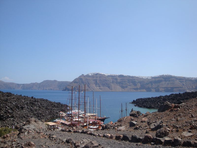 Ships in the harbor at the foot of the volcano, Nea Kameni island