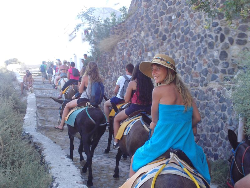 Riding donkeys on the way upstairs to Oia, Santorini