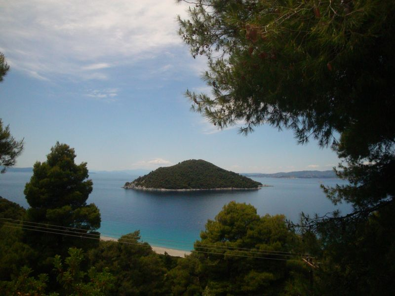 004. View of green Dhasia Island (Δασειά) - And Milia beach (Μηλιά)