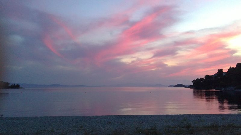 031. Charming and deserted Panormos beach - (Πάνορμος) in pink rays of Sunset