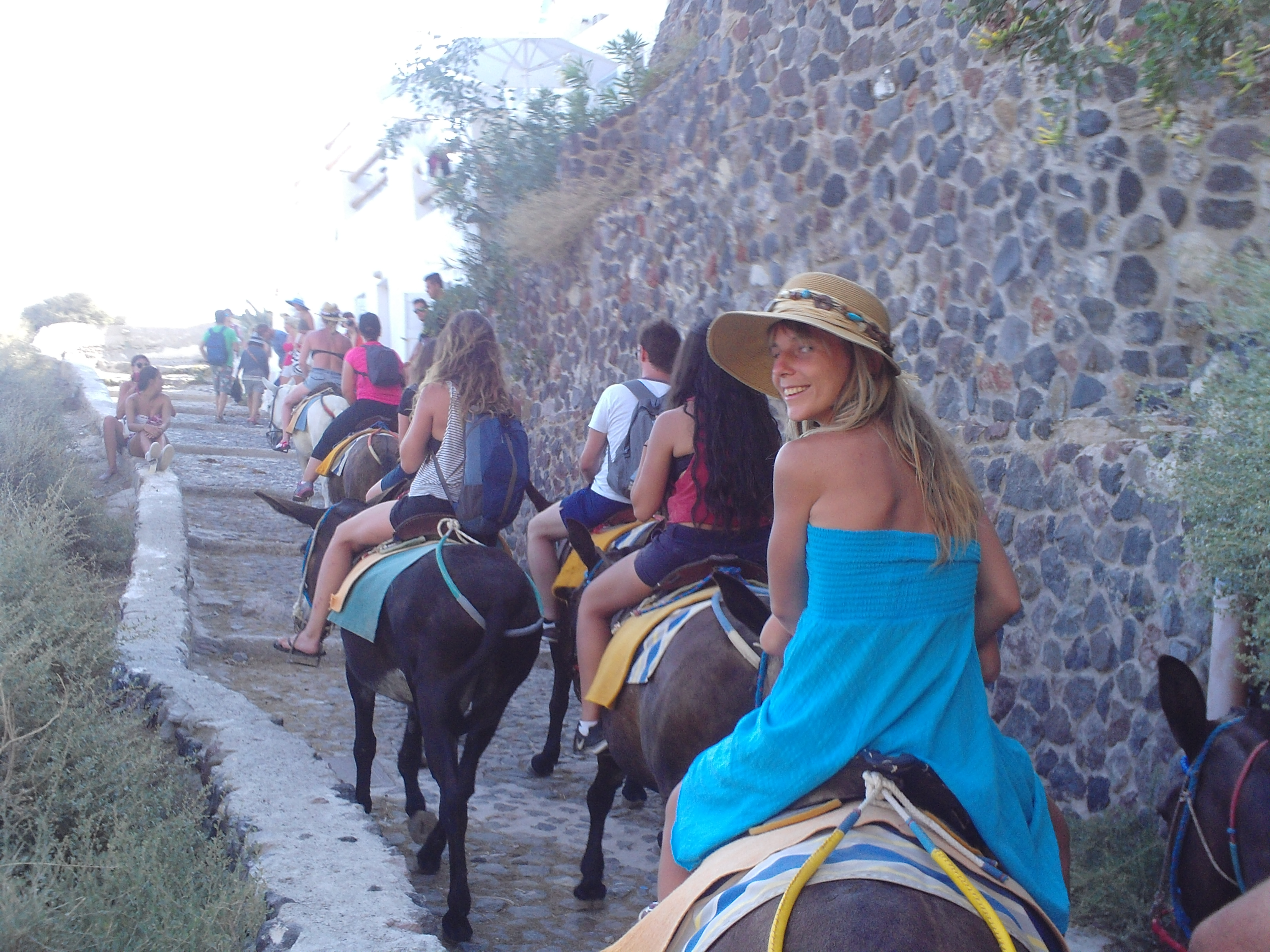 17. Riding donkeys on the way upstairs to Oia - Santorini