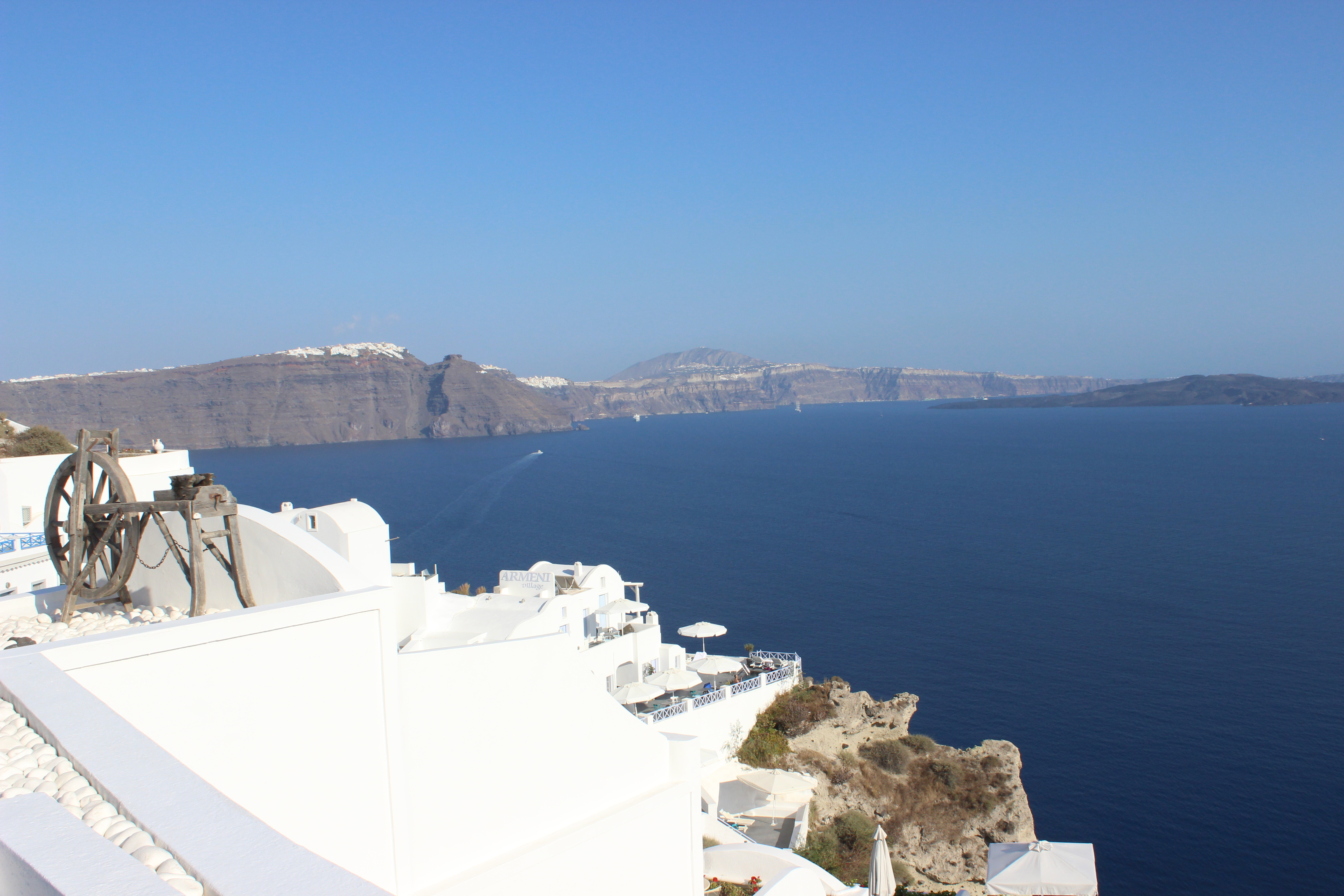21. Breathtaking view with a spinning wheel - Oia, Santorini