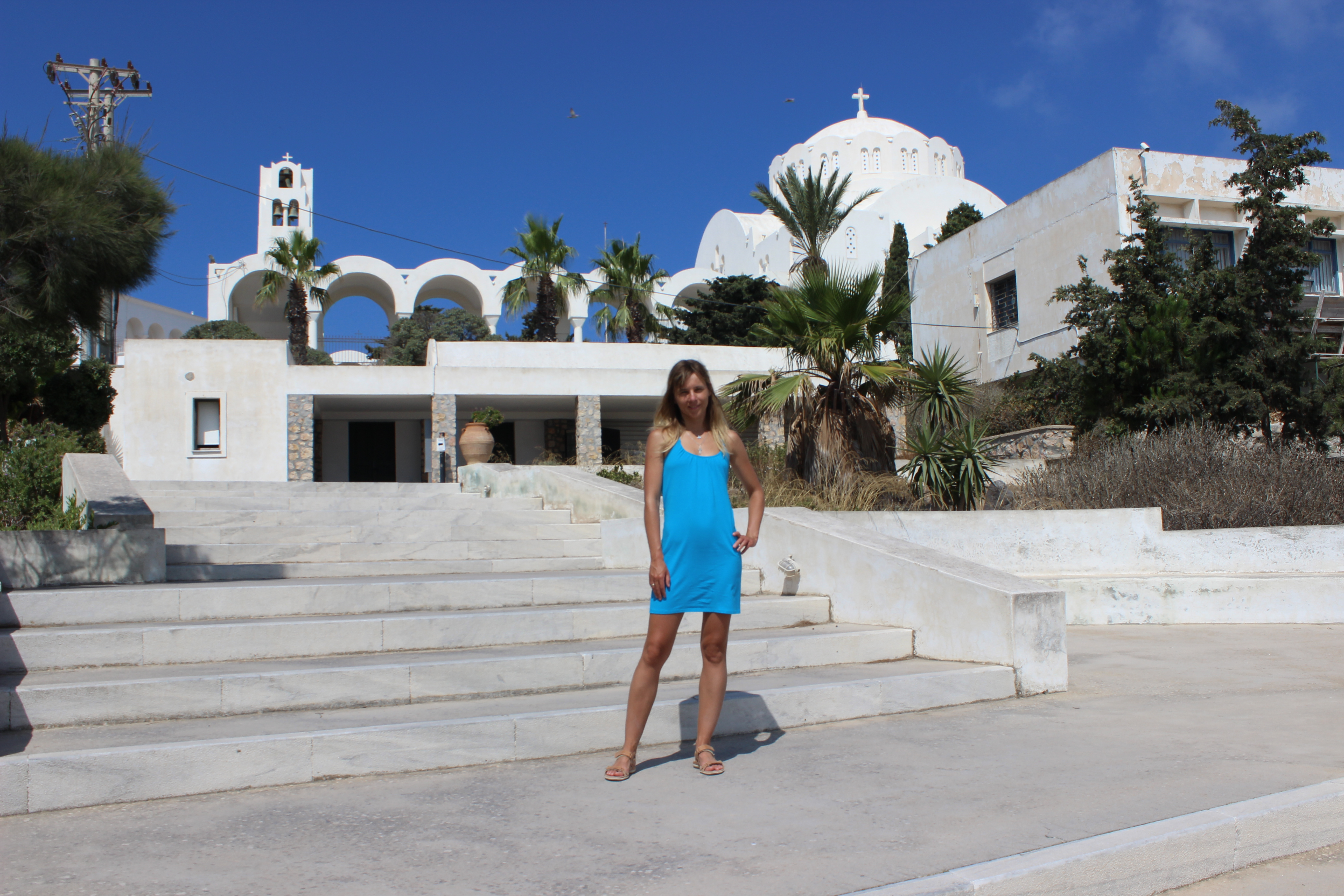 34. At the entrance to the museum of Firá (Φηρά) - There is a main cathedral of Firá in the background. Santorini
