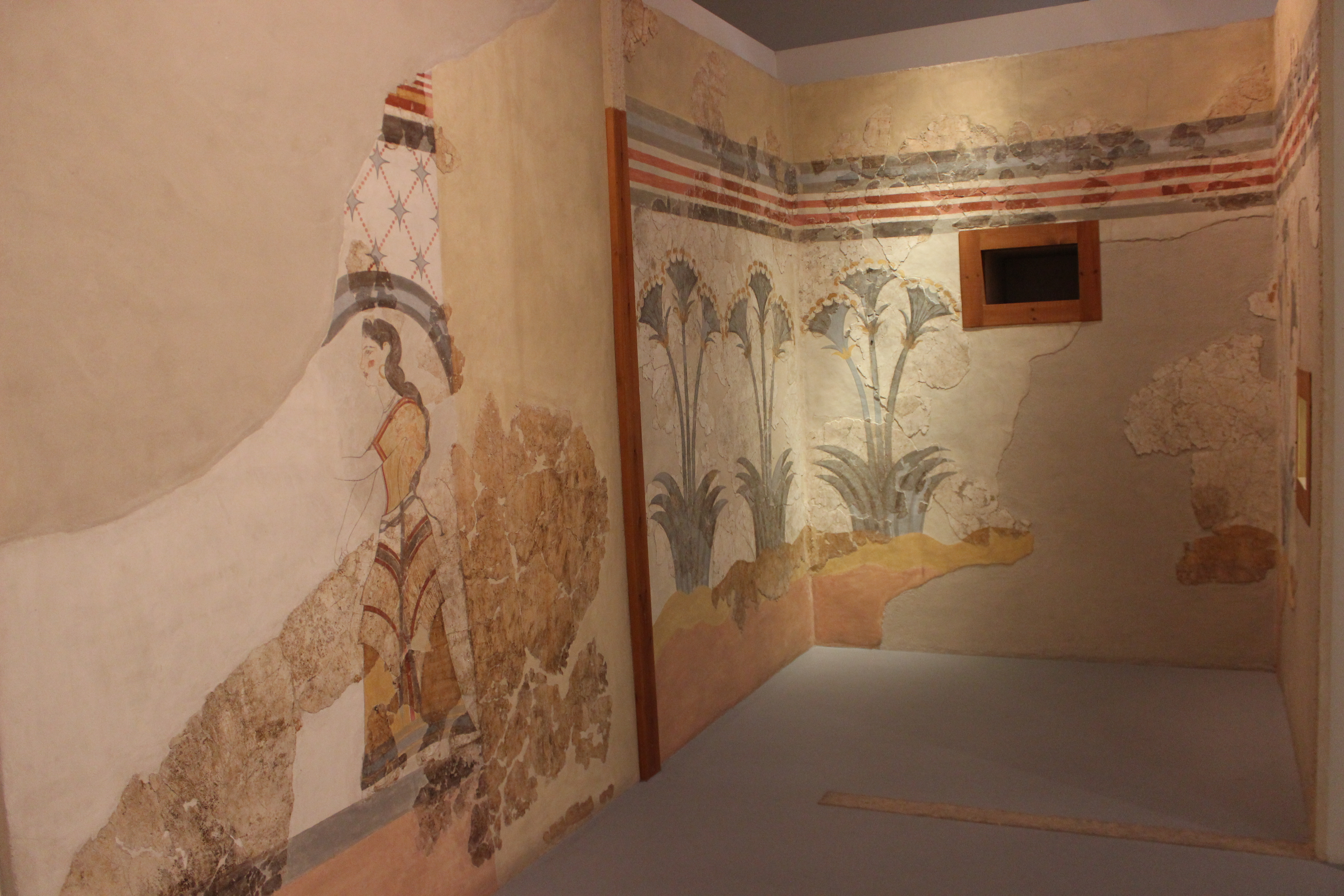 37. Egyptian motif – Woman with papyrus - Fresco with a picture of papyrus flowers, Akrotiri (Ακρωτήρι). Museum of Firá, Santorini