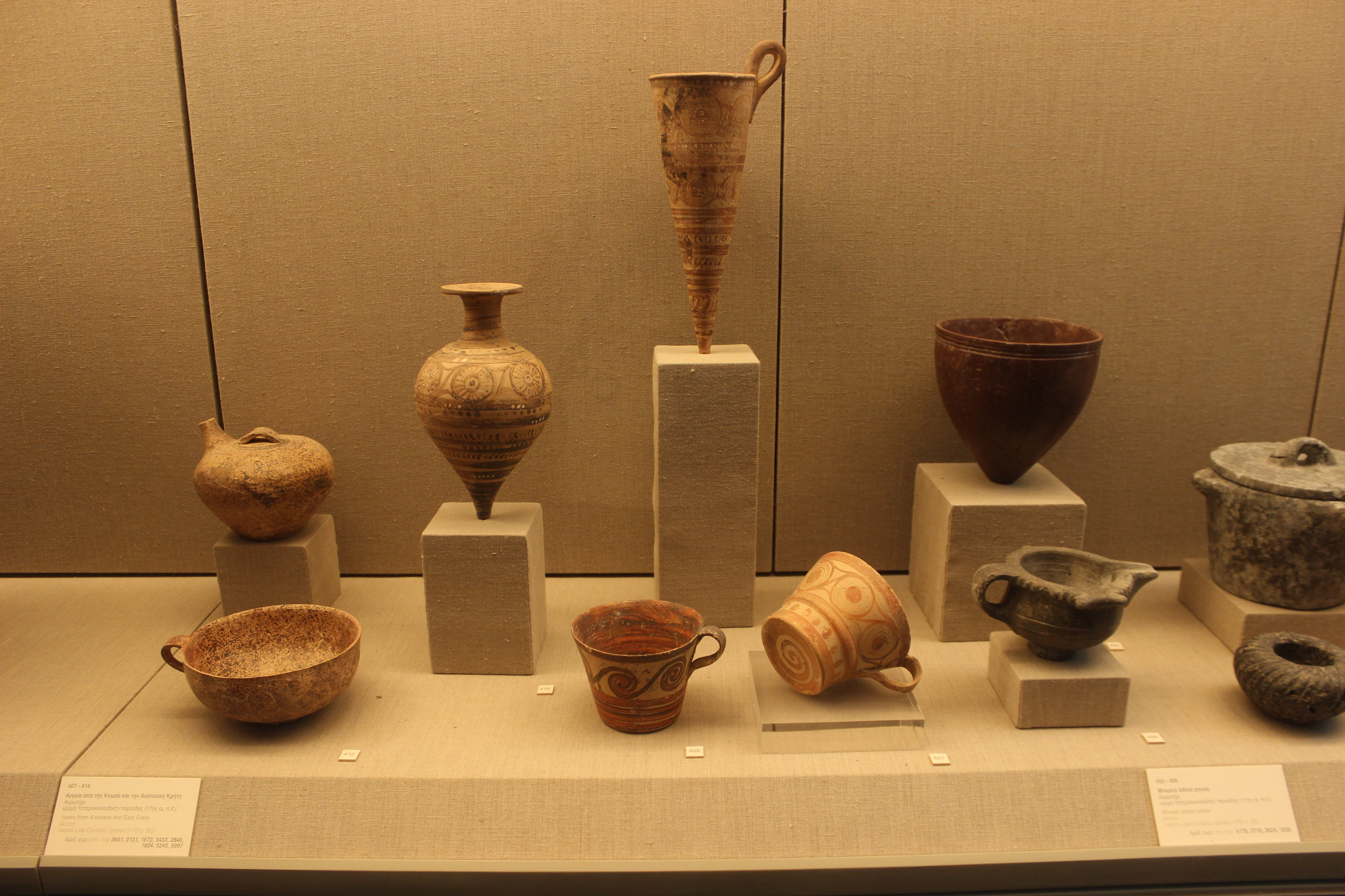 38. Vases from Knossos and East Crete - 17th c. BC. On the right – Minoan stone vases, 17th c. BC, Akrotiri (Ακρωτήρι). Museum of Firá, Santorini